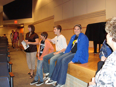 High school members of CLEAR wait their turn to speak to new junior high members about their participation in the organization. Members shown are Kyle S., Kenton H. and Katelyn S.