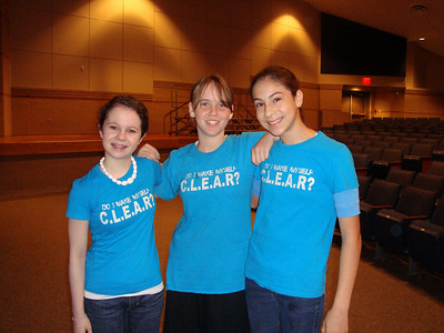 Friendswood Junior High CLEAR members model t-shirts that will go on sale for $5. Three eight graders are: Anne B., Lydia G. and Ana M..