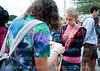 Sophomores Rachel Hoelting and Anna Lindholm pray together on Sep. 22 in front of the school at Club 121's Meet Me At The Pole. The Pole isa national event held every year.