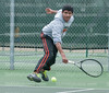 Senior Chris D'Silva returns a ball playing Olathe South on March 31 at our home court. Chris has been on the Northwest Tennis team all four years and has been on varsity since junior year.