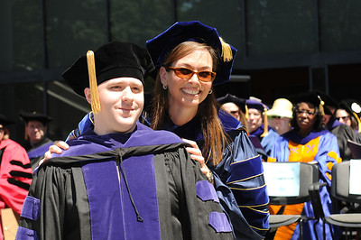 """As """"Outstanding Professor of the Year,"""" Kay Levine hooded students during the diploma ceremony."""