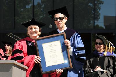 Professor Polly Price receives the Ben F. Johnson Faculty Excellence Award from Dean Robert Schapiro.
