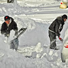 My neighbor hired these guys to dig out her car.