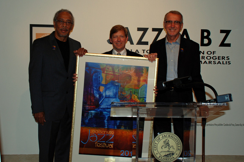 Jacksonville Jazz Hall of Fame inductee Na'im Rashid, Mayor John Peyton, and Bob Bednar, with 2010 jazz poster.
