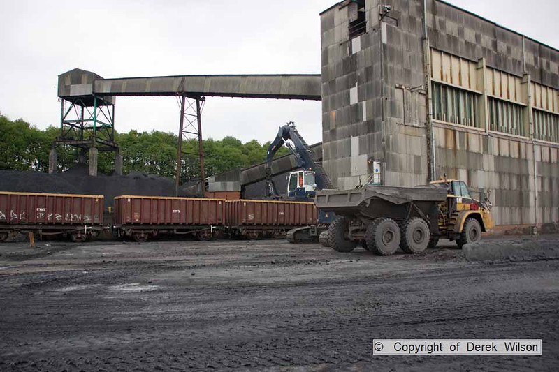 100525-002     Unloading coal brought from Daw Mill colliery, to be washed & then blended with Welbeck coal.