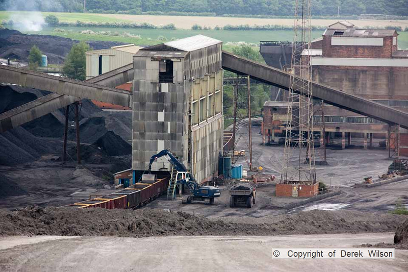 100525-025     A view from the spoil heaps, showing the prep plant & washery, plus Daw Mill coal being unloaded. Note the fire in the top left of the picture, this caused a panic due to being near the stock pile area, it was a rough ride, rushing to it in the land rover!!