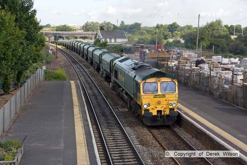 100706-008     Freightliner class 66/5 no. 66559 is seen passing through Patchway with train 6A21 Cardiff, Pengam - Theale, bogie hoppers loaded with stone.