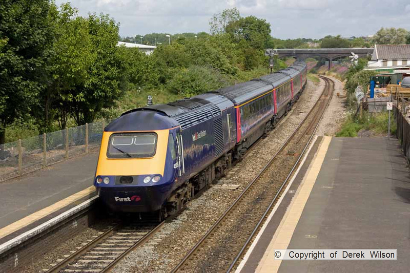 100706-024     A First Great Western HST, powered by 43165 (front) & 43015 (rear) is seen from the footbridge at Patchway, with the 09.45 London Paddington - Swansea. Captured heading away from the camera, with 43015 nearest.