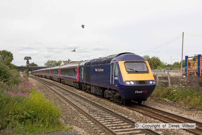 100706-058      First Great Western  HST led by class 43 no. 43079 speeds past Patchway with the 13.55 Cardiff - London Paddington. 43002 is in the distance, at the rear.