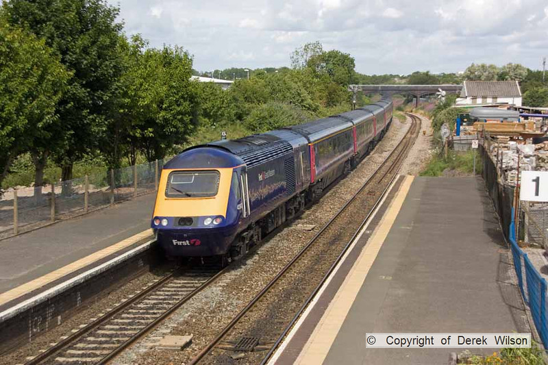 100706-028     A First Great Western HST, powered by 43198 (front) & 43193 (rear) is seen from the footbridge at Patchway, with the 10.15 London Paddington - Cardiff Central. Captured heading away from the camera, with 43198 nearest.