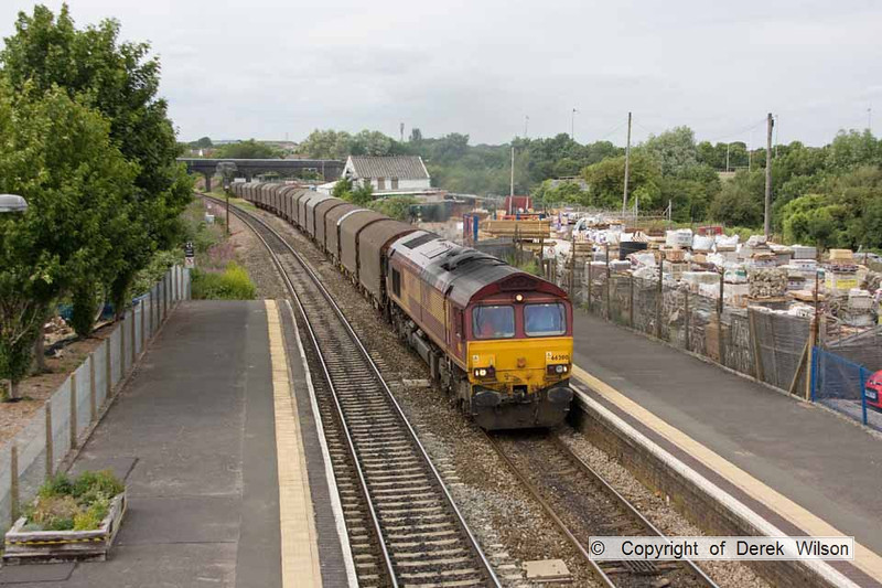 100706-078     EWS class 66/0 no. 66200 is seen passing through Patchway, powering train 6O78 Margam - Dollands Moor, sleel in covered wagons.
