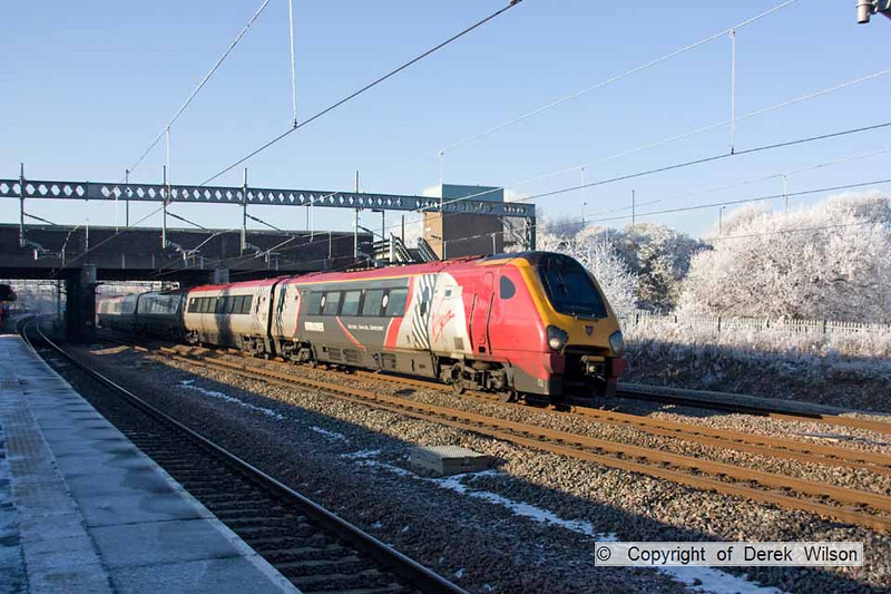 101207-025     Virgin Trains class 221 'super voyager' no. 221115 heading south throughj Tamworth.