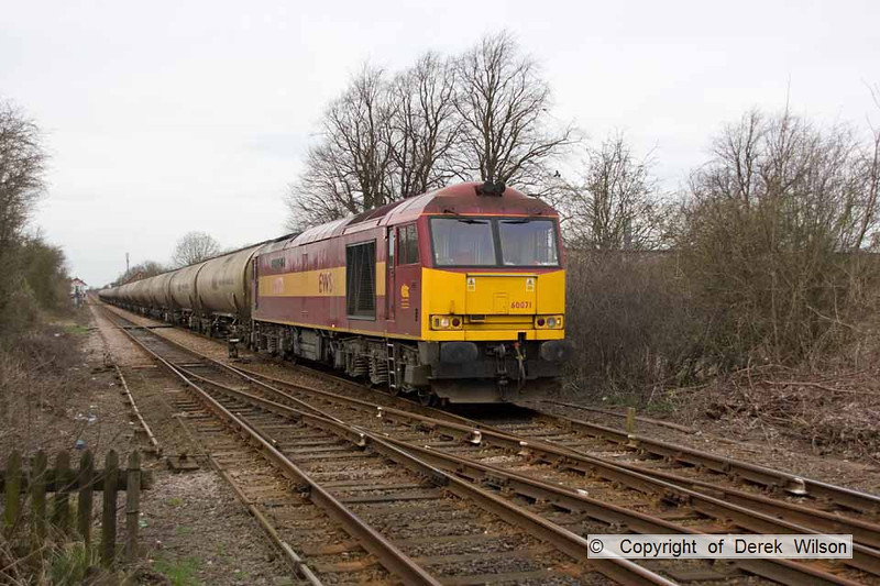 100406-003     D B Schenker class 60 no 60071 Ribblehead Viaduct is seen passing Bingham, powering train 6E82 Rectory Junction-Lindsey, empty fuel-oil tanks.