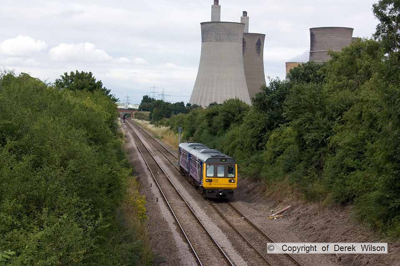 100728-017    The 16.27 Lincoln Central-Hull Northern Rail service, formed by pacer unit, class 142 no 142087 is seen passing West Burton power station.