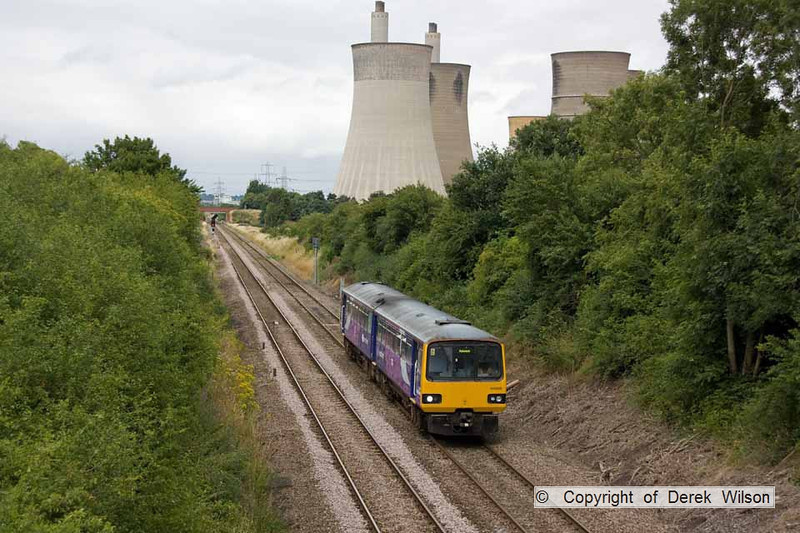 100728-015     The 15.27 Lincoln Central-Adwick Northern Rail service, formed by pacer unit no 144006 is seen passing West Burton power station.