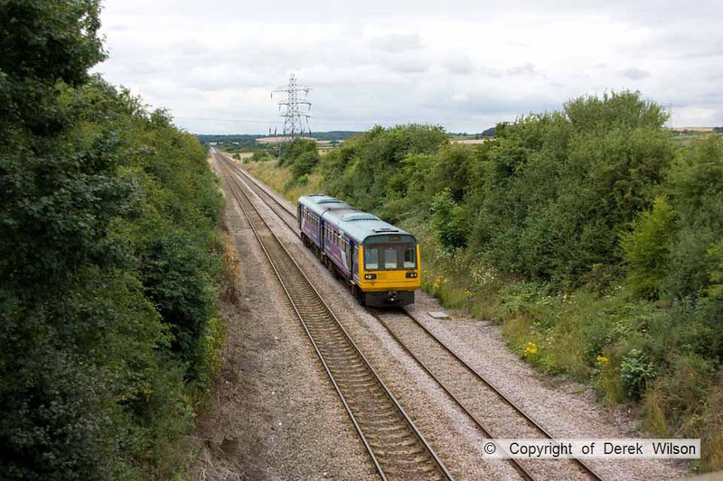 100728-006     Northern Rail class 142 no 142019 is seen from Station Road, Sturton le Steeple, near West Burton with the 12.33 Meadowhall-Lincoln Central.