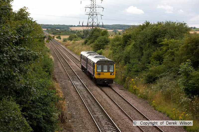 100728-013     Northern Rail class 142 no 142087 is seen from Station Road, Sturton le Steeple, near West Burton with the 14.33 Meadowhall-Lincoln Central.