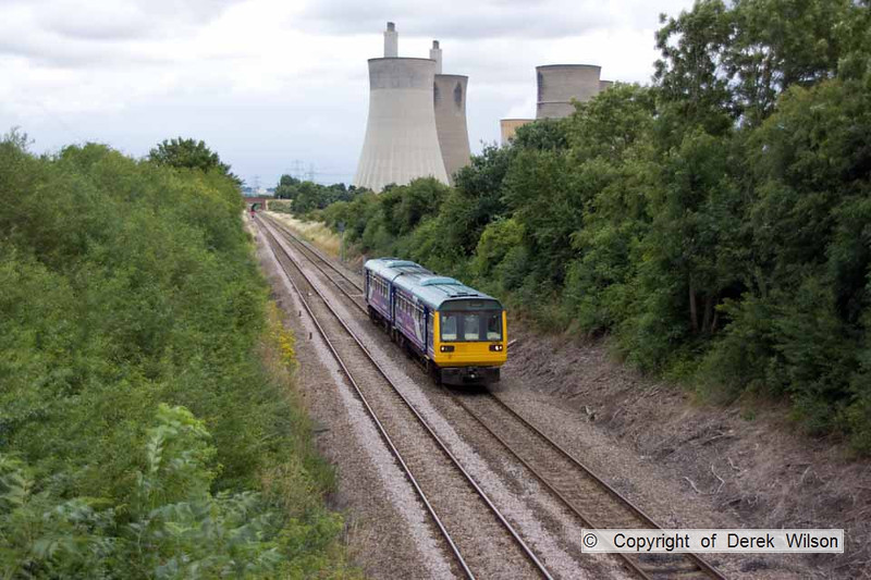 100728-007     Northern Rail class 142 no 142084 is seen passing West Burton power station with the 13.27 Lincoln Central-Adwick.Captured from Station Road, Sturton le Steeple, Nottinghamshire.