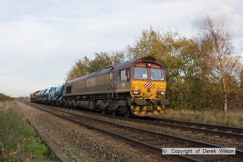 101106-016     A number of Euro Cargo Rail class 66 locomotives recently returned from France, some being deployed on the autumn 'leaf busters'. Two of these, no. 66123 working 'top & tail' with classmate 66033 are seen at Rolleston, powering train 3J88 Toton-Toton.