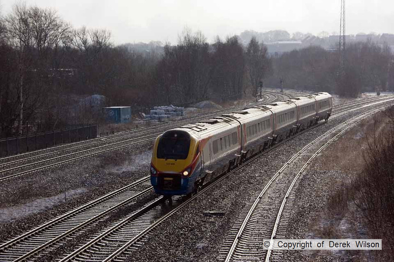 100210-001     Meridian unit no 222009 is seen at Clay Cross with the 11.25 London St Pancras-Sheffield. This image was captured after a snow shower, which melted straight away & gave a nice effect.