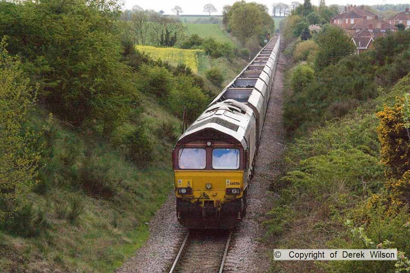 100507-004     DB Schenker class 66/0 no 66096 passes Top Sandy Lane, Warsop, on the Welbeck branch, powering train 4K48 Ferrybridge power station-Welbeck colliery, empty coal hoppers.