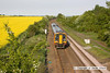 100521-001     East Midlands Trains class 158 no 158780 is seen heading away from the camera, passing Oatfield lane near Radcliffe on Trent, with the 17.45 Nottingham-Skegness.