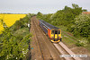 100521-002     The 16.10 Skegness-Nottingham, formed by 156413 is seen from Oatfield lane, near Radcliffe on Trent.