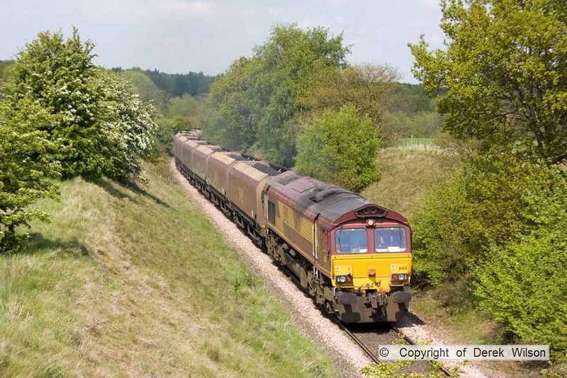 100518-005     DB Schenker class 66/0 no 66131 powers up the colliery branch towards Broomhill lane, hauling train 6Y49 Welbeck colliery-Ferrybridge power station, loaded coal hoppers.