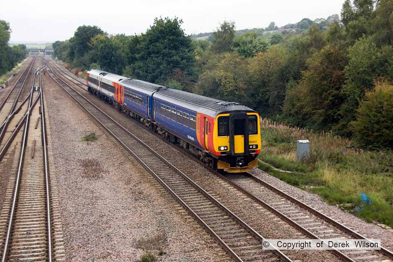 100910-002     East Midlands Trains units no's 156403 & 158780 form the 09.52 Liverpool Lime Street - Norwich & are seen passing Tupton, near Chesterfield.
