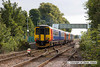 100904-005     A pair of East Midlands Trains class 156 units with a class 153 between them form the 09.55 Nottingham - Skegness summer Saturday service. The trio, 156401 (furthest) at the front, 153326 & 156403 are seen leaving Bingham.