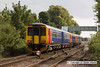 100904-004     A pair of East Midlands Trains class 156 units with a class 153 between them form the 09.55 Nottingham - Skegness summer Saturday service. 156401 (furthest) at the front, 153326 & 156403 are seen at Bingham, with the rearmost unit stopped short of the platform.