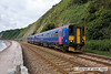 100704-001     FGW class 153 units no 153370 & 153368 speed alongside the sea wall at Teignmouth with the 10.10 Paignton-Exeter St Davids.