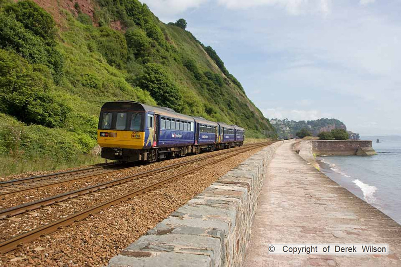 100708-008     A pair of FGW pacer units heading away from the camera , 142001 & 142064 are seen alongside Teignmouth sea wall with the 10.18 Paignton - Exmouth.
