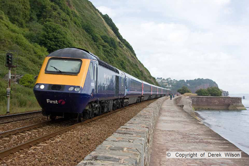 100708-003      A FGW HST set led by 43032 heads alongside the sea wall at Teignmouth, with the 07.30 London Paddington-Penzance.