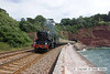 100704-012     A regular on summer Sundays is The Torbay Express, seen here leaving Parsons tunnel at Teignmouth, powered by Great Western King class 4-6-0 no 6024 King Edward 1.