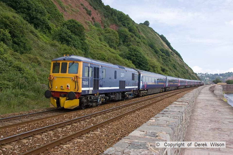 100708-011     Electro-diesel, class 73 no 73212 looking rather smart, is seen at the rear of train 5O66, 10.00 Plymouth Laira-Eastleigh & is captured passing Teignmouth.