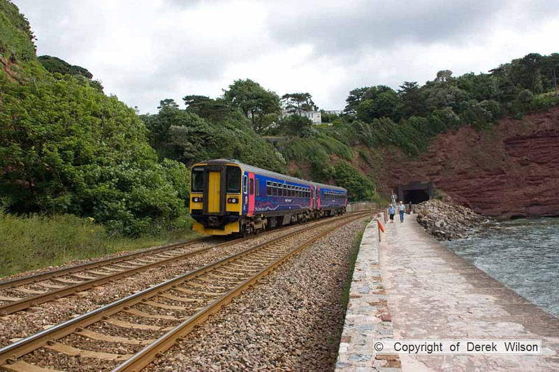 100704-002      FGW class 153 units no 153368 & 153370 are seen heading away from the camera, speeding alongside the sea wall at Teignmouth with the 10.10 Paignton-Exeter St Davids.