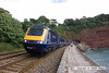 100704-008      A First Great Western HST with 43148 leading is seen at Teignmouth, leaving Parsons tunnel with the 08.00 London Paddington-Penzance.