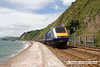 100714-014     The 08.57 London Paddington-Penzance speeds along the sea wall at Teignmouth, seen heading away from the camera with 43015 at the rear.