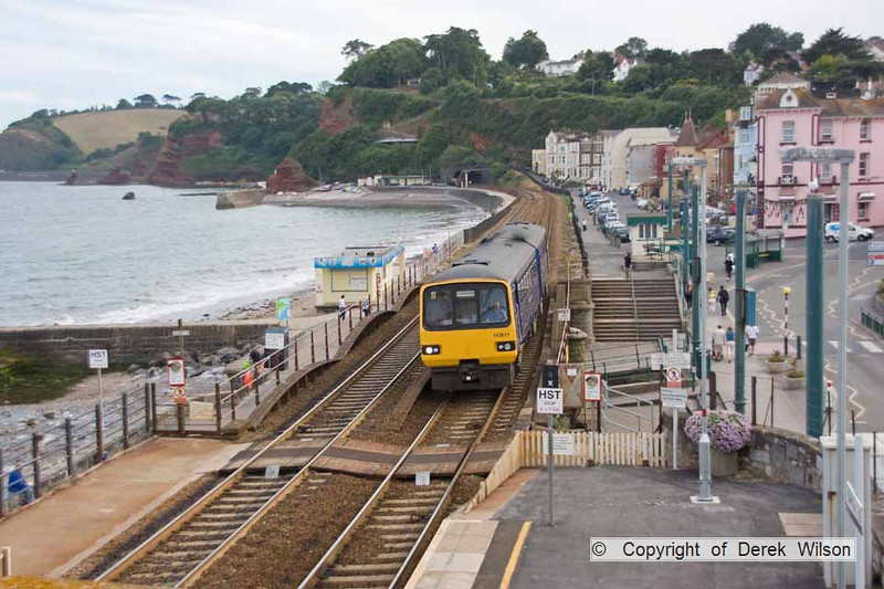 100708-024     The FGW 17.52 Paignton - Exmouth service is seen arriving at Dawlish, formed by class 143, pacer unit no 143611.