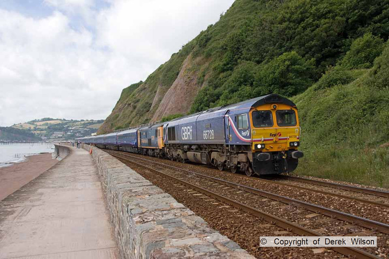 100708-009     Seen passing Teignmouth is GBRF class 66 no 66728  with  off lease buffet coaches 40736, 40725, 40726, 40744, 40738, 40709,& 40745 & two electro-diesels, class 73, with no. 73206 tucked in behind the 66 & no. 73212 at the rear of the train, running as  5O66, 10.00 Plymouth Laira - Eastleigh.
