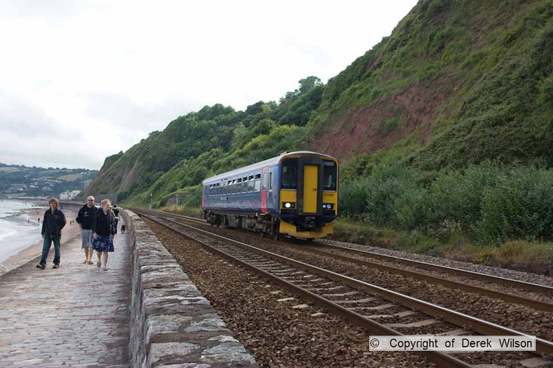 100704-017     Class 153 unit no 153368 is seen heading towards Dawlish, on the Teignmouth sea wall, with the 17.04 paignton-Exeter St Davids.