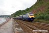 100704-015     The 14.45 Penzance-London Paddington speeds along the sea wall at Teignmouth, powered by 43196 (nearest) & 43148.