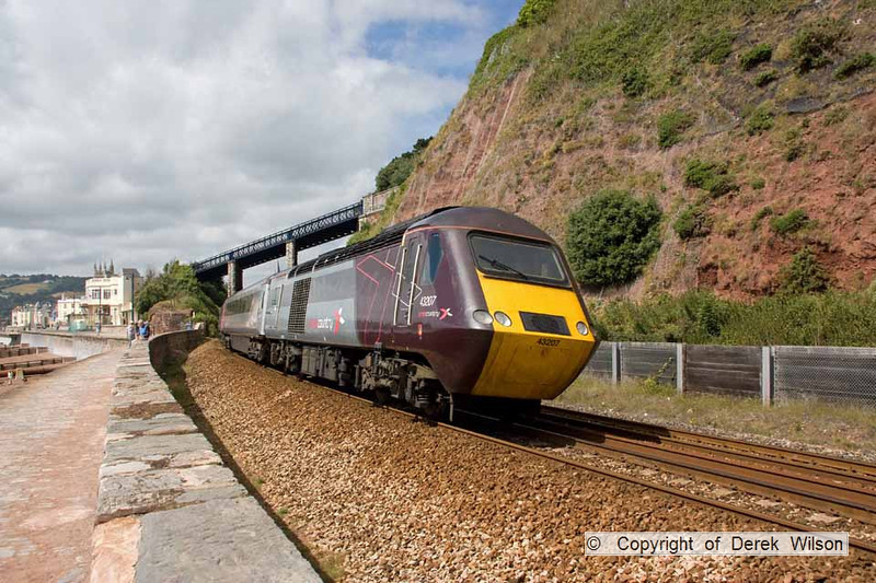 100708-016     The 06.00 Leeds-Paignton heads away from the camera, with class 43 no 43207 seen bringing up the rear It is seen rounding the curve as it leaves the sea front at Teignmouth.