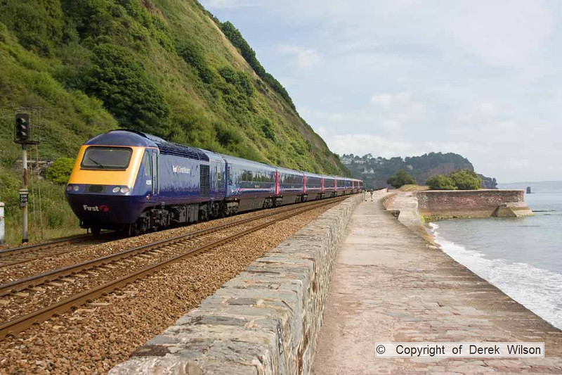 100708-006     FGW powercars 43156 & 43191 provide the traction for the 07.38 Penzance-London Paddington, seen heading away from the camera with 43191 nearest & is captured passing the scenic sea wall at Teignmouth..