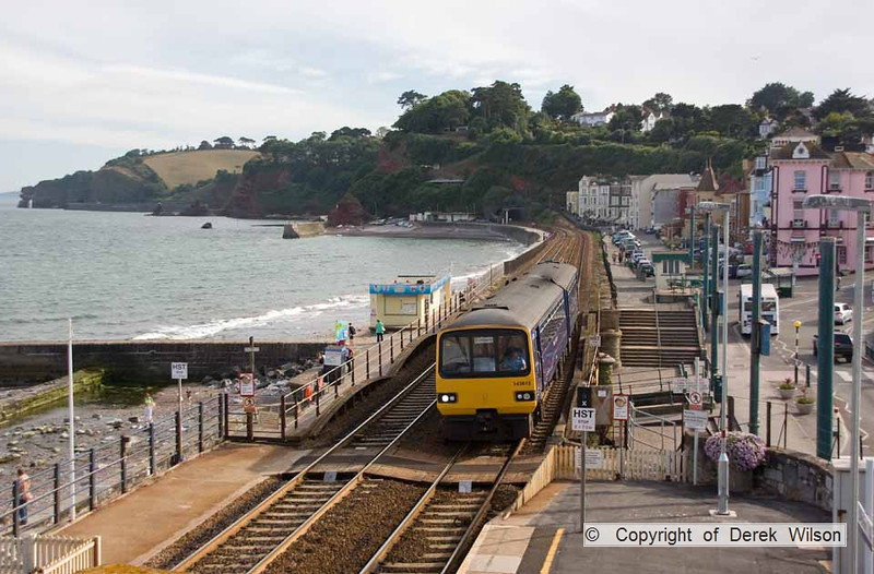 100708-018     FGW pacer unit no 143612 is captured from the footbridge on Dawlish station, forming the 17.25 Paignton - Exmouth.
