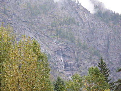 mountainside waterfall as seen from near McDonald Falls, Glacier National Park, Montana