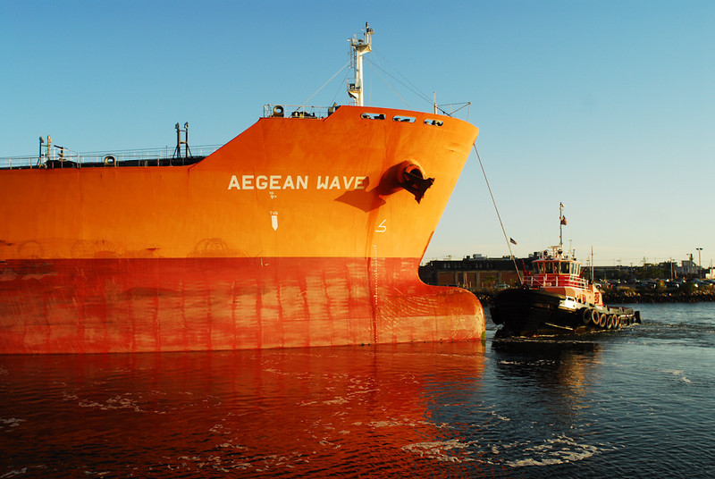 The orange tanker Aegean Wave backs out of Chelsea Creek.