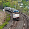 The first inbound Downeaster from Portland crosses Whittenmore Pond in Woburn, ten miles from Boston.