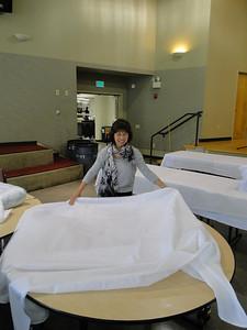 Setup: Rita clothes the tabletops